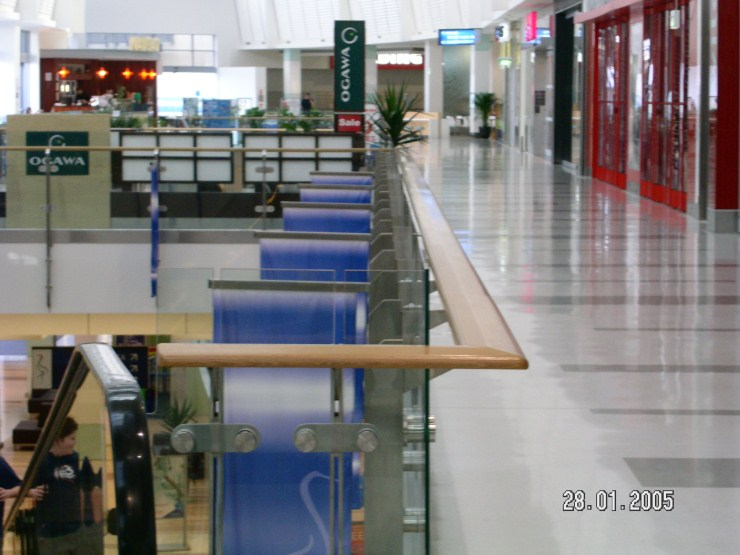Rhodes Shopping Centre Glass Balustrade with Timber handrail